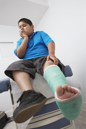 unknown age: Boy with leg in plaster cast