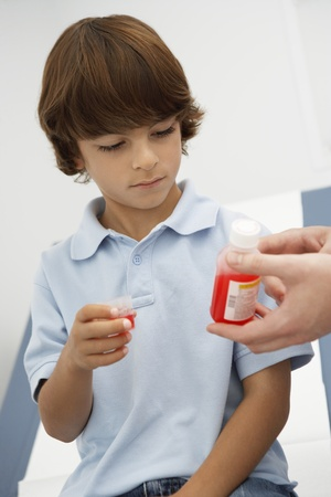 Boy taking medicine Stock Photo - 12737331