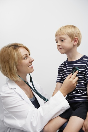 Boy being examined by female doctor Stock Photo - 12737374