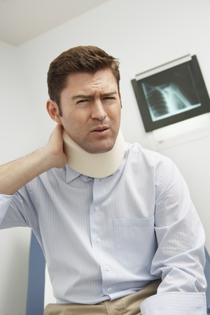 Man wearing neck brace in hospital Stock Photo - 12737410