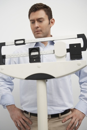 Man standing on weighing scales in hospital Stock Photo - 12737427