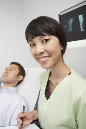 Doctor with male patient in hospital Stock Photo - 12737433