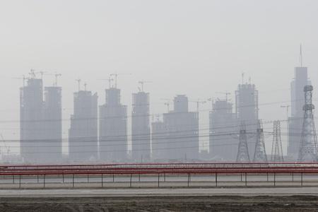 racetrack: Dubai UAE partial view of Dubai?s skyline from Nad Al Sheba Camel Racetrack LANG_EVOIMAGES