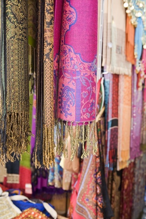 UAE Dubai colourful pashminas and fabrics for sale at Bur Dubai souq Stock Photo - 12737507