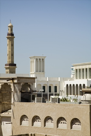 bur dubai: UAE Dubai old windtowers and minaret of the Grand Mosque in Bur Dubai  LANG_EVOIMAGES