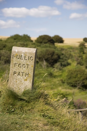 Stone sign marking footpath Stock Photo - 12737521