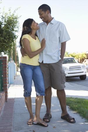 Couple walking down pavement Stock Photo - 12737523
