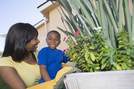 Woman and son tending plants Stock Photo - 12737526