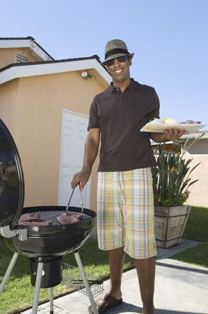 Man at a barbeque Stock Photo - 12737531