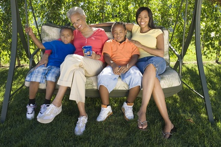 Family  on outdoor swinging chair Stock Photo - 12737537