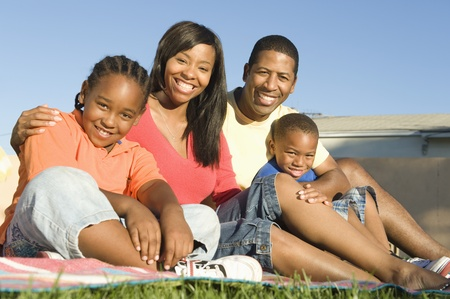mixed age range: Family sitting on grass
