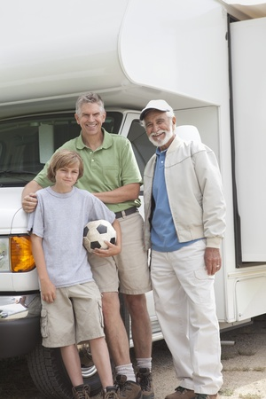 Father son and grandson stand with RV home Stock Photo - 12737588