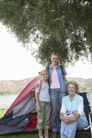 Mother daughter and grand-daughter stand outside tent Stock Photo - 12737611