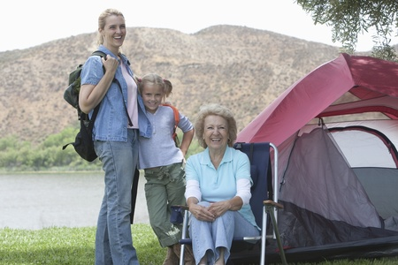 Mother daughter and grand-daughter outside tent Stock Photo - 12737613