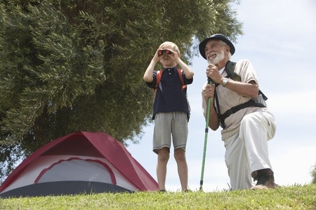 Grandfather and grand-son bird watching Stock Photo - 12737622