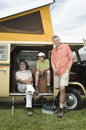 campervan: Father son and grandson in campervan prepare to go fishing LANG_EVOIMAGES