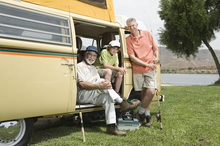 Father son and grandson in campervan prepare to go fishing Stock Photo - 12735587
