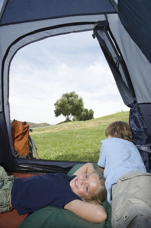 Brother and sister lie in a tent Stock Photo - 12735582