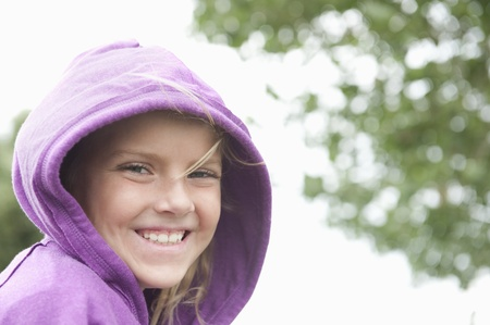 casual hooded top: Portrait of a girl in a purple hooded top