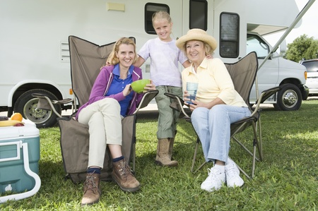 recreational vehicle: Mother daughter and grand daughter sit outside RV home