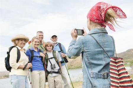 bandana girl: Girl in bandana photographing family on activity holiday
