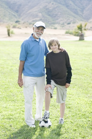 Portrait of grandfather and grand-son with football Stock Photo - 12737637