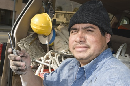 middle easterners: Portrait of construction worker with mobile phone