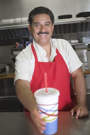 Portrait of man serving drink in restaurant Stock Photo - 12737647
