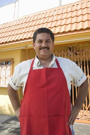 middle easterners: Portrait of restaurant owner outdoors LANG_EVOIMAGES