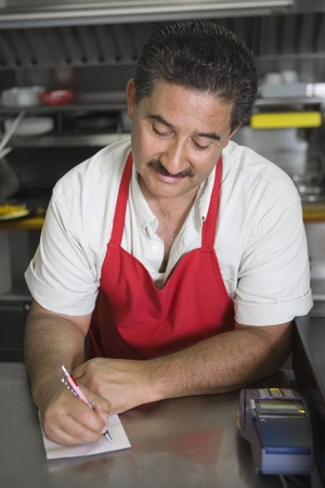 middle easterners: Man writing order in restaurant