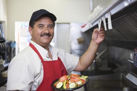 eye service: Portrait of man working in restaurant kitchen