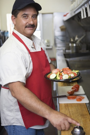middle easterners: Portrait of man working in restaurant kitchen