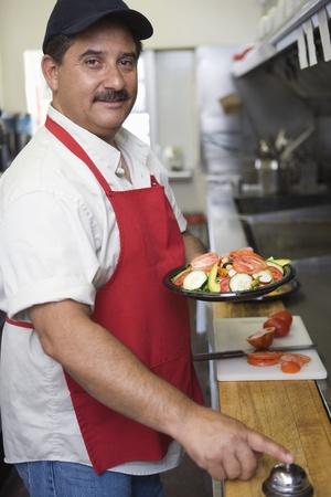 Portrait of man working in restaurant kitchen Stock Photo - 12737652