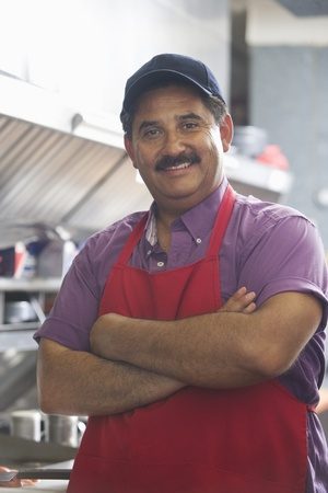 middle easterners: Portrait of man in restaurant kitchen LANG_EVOIMAGES