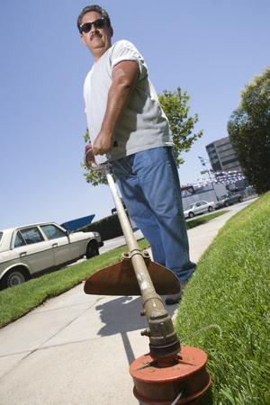 Portrait of man cutting grass Stock Photo - 12737655