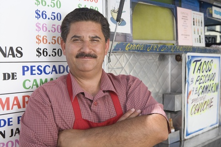 middle easterners: Portrait of man outside cafe