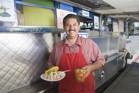 middle easterners: Portrait of man outside mobile cafe