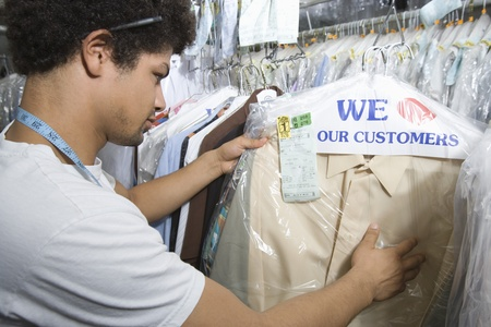 dry cleaners: Young man working in dry cleaners