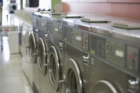 launderette: Row of washing machines in launderette