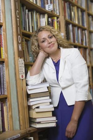 Portrait of female librarian by bookshelf Stock Photo - 12737683