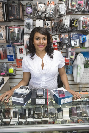 Portrait of young woman working in mobile phone shop Stock Photo - 12735650