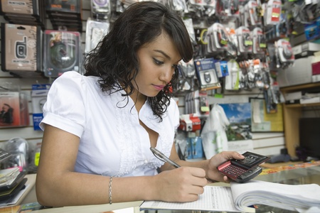 work material: Young woman working in mobile phone shop