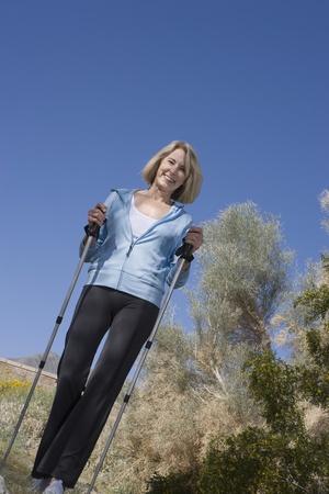 walking pole: Mature woman with walking poles