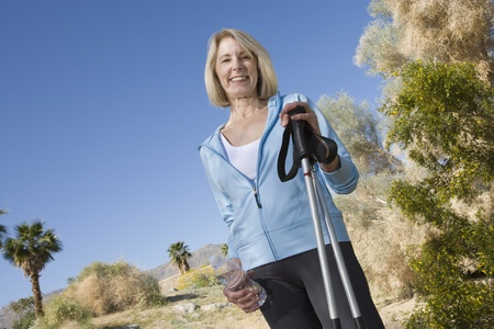 Mature woman holds walking poles Stock Photo - 12737693