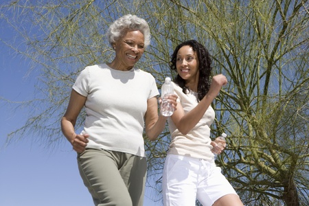 Mother and daughter jog together Stock Photo - 12735629