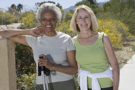 walking pole: Senior women stand with walking poles LANG_EVOIMAGES