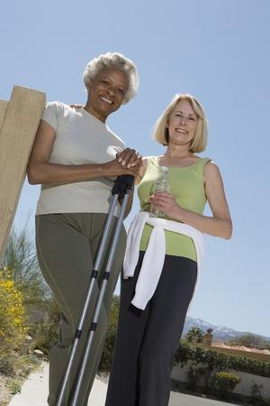 senior women: Senior women stand with walking poles LANG_EVOIMAGES