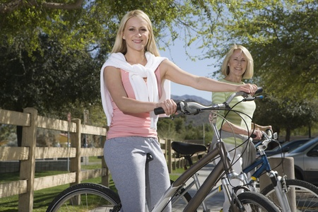 Mother and daughter with mountain bikes Stock Photo - 12735625