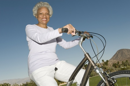 Senior woman on mountainbike Stock Photo - 12735652