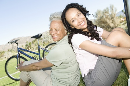 Mother and daughter sit in park with mountain bikes Stock Photo - 12735667